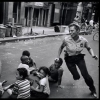 USA. New York City. 1978. A policewoman plays with local kids in Harlem. - Леонард Фрид (Leonard Freed)